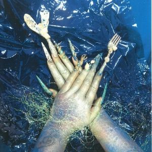 Hands crossed over each other with long patterned nail extensions against a shiny blue background by a Koestler Awards entrant from HM Young Offenders Centre Hydebank Wood.