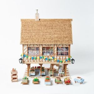 Part of a matchstick village including a matchstick building and market stands by a Koestler Awards entrant from HM Prison Parc.