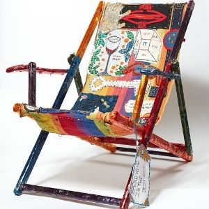 A deckchair with wrapped in colourful materials and embroidered designs by a Koestler Awards entrant from HM Prison Bronzefield.