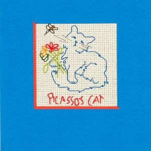 A handmade card with an embroidered blue cat holding flowers with the text 'Picasso's Cat' below on a blue card by a Koestler Awards entrant from HM Prison Frankland.