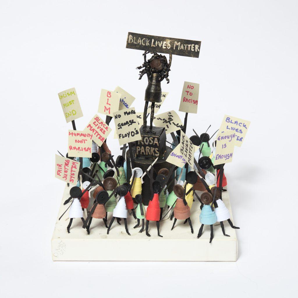 A sculpture of a Black Lives Matter protest