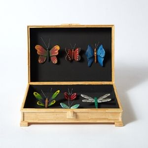A wooden box with six colourful butterflies by a Koestler Awards entrant from HM Prison Wakefield.