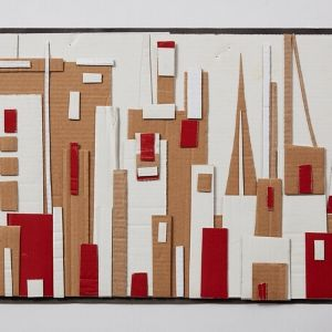 A skyline made of red and white paper and carboard of a Polish city by a Koestler Awards entrant from HM Young Offenders Institution Swinfen Hall.